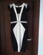 Sukienka wyszczuplająca midi