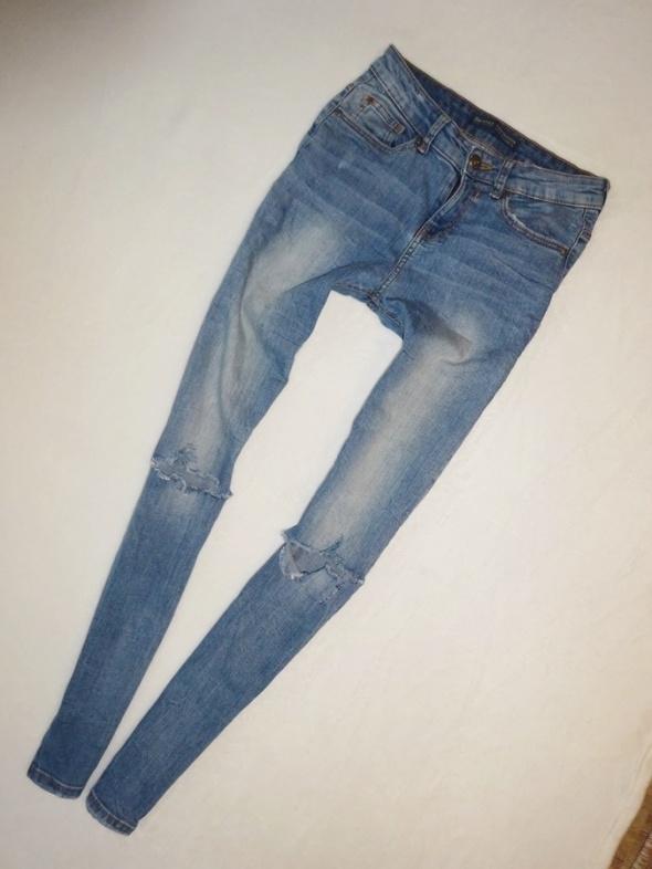 Bershka spodnie rurki jeansy dżins dziury z dziurami 36 S...