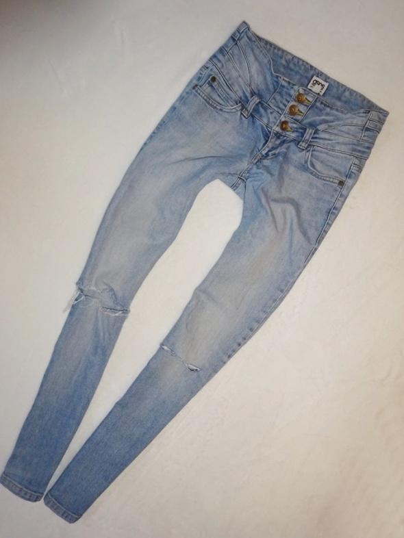 ASOS spodnie rurki jeansy z dziurami dziury 36 S...