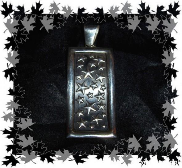 Stary oksydowany srebrny wisior w gwiazdy