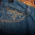 Jeansy ze złotymi dodatkami