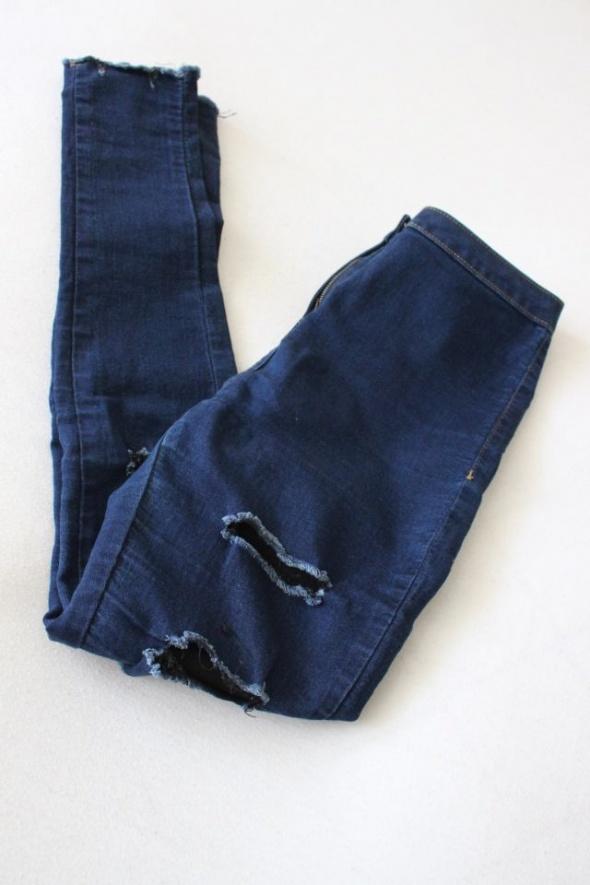 spodnie jeansowe z dziurami m