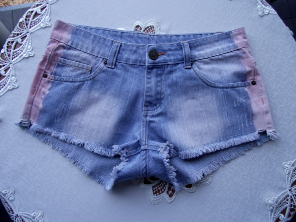 Krótkie spodenki szorty jeansowe jasnoniebieskie strzępione New...