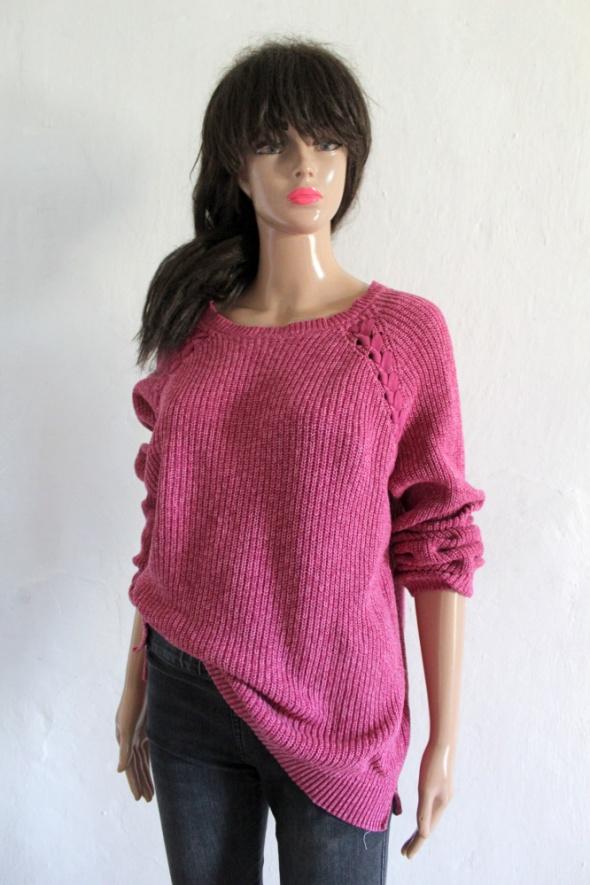 Różowy sweter ma długi rękaw r 44...