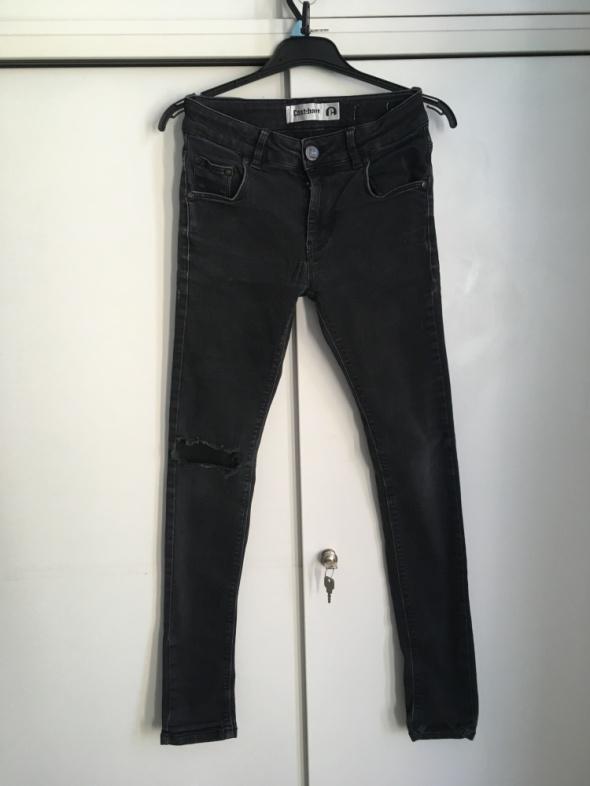 jeansy z dziurą S M