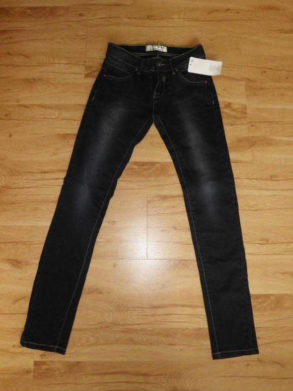Nowe damskie spodnie jeansowe rozm 25