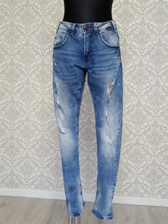 męskie niebieskie jeans spodnie Cropp