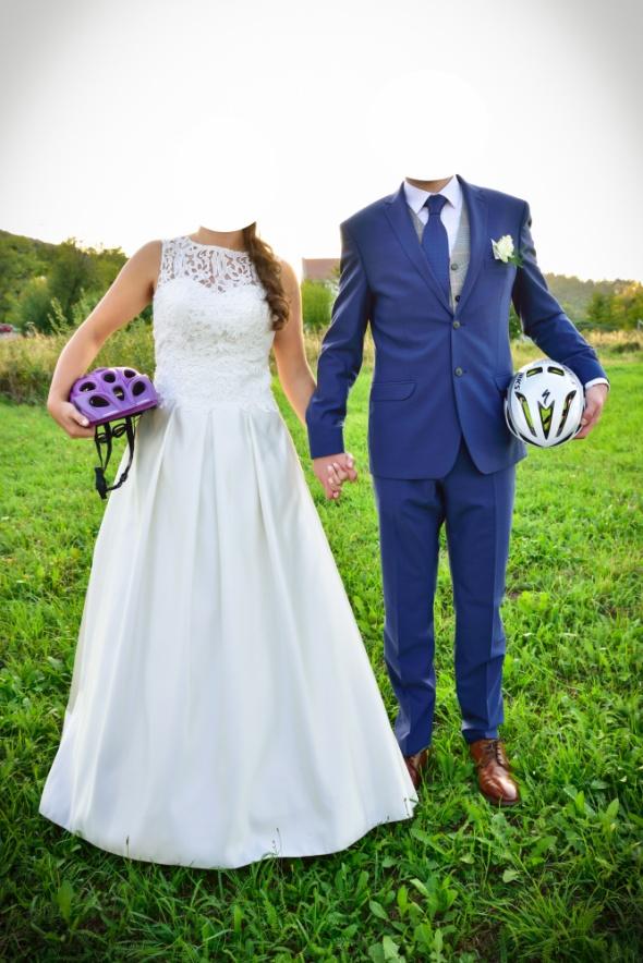 Elegancka suknia ślubna 38