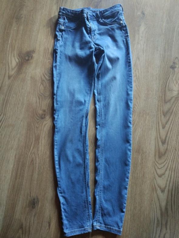 Spodnie Reserved niebieskie jeggingsy 32