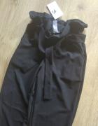 Eleganckie czarne spodnie z kokardą dopasowane...