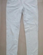 Białe getry legginsy koronka Cubus...