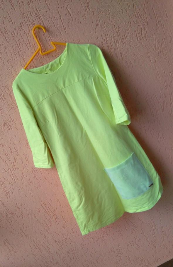 Żółta trapezowa pastelowa sukienka lato wiosna