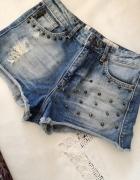 Krótkie spodenki jeansowe szorty przecierane z ćwiekami...