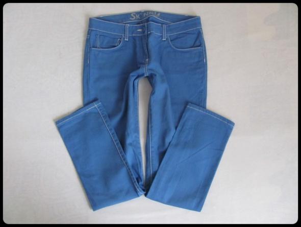 Spodnie niebieskie SKINNY rozmiar 40 L i 42 XL stan bdb