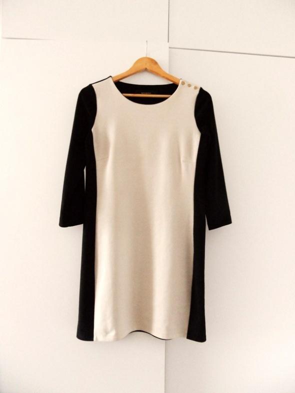 Suknie i sukienki Beżowo czarna sukienka Reserved elegancka must have