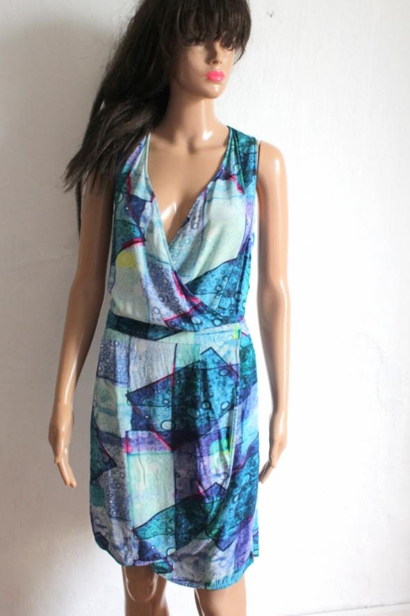Kopertowa letnia sukienka z kieszeniami r L