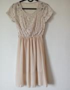 Kremowa sukienka z koronkową górą...