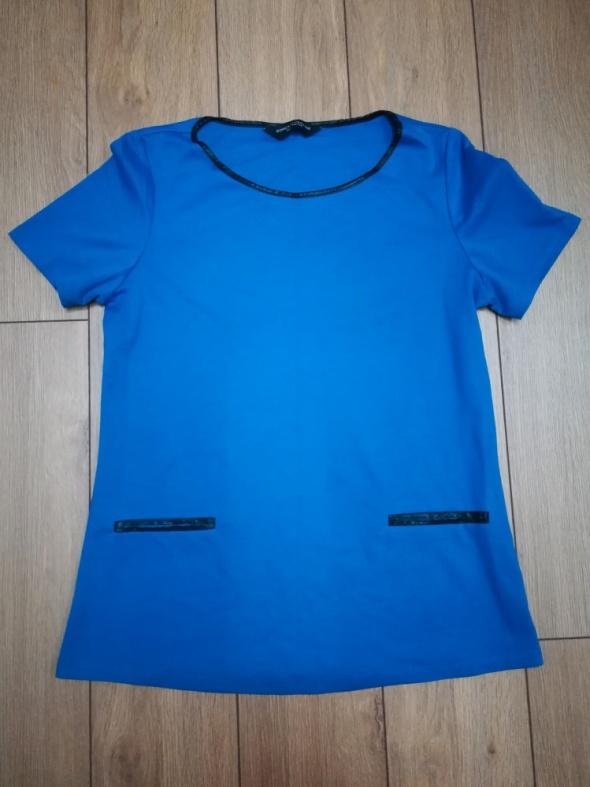 Niebieska elegancka bluzka...