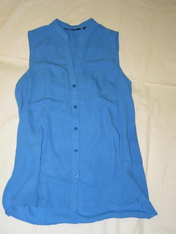 Bluzki Niebieska szyfonowa bluzka na guziczki