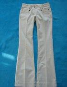 Białe spodnie dżinsy NEXT złote akcenty