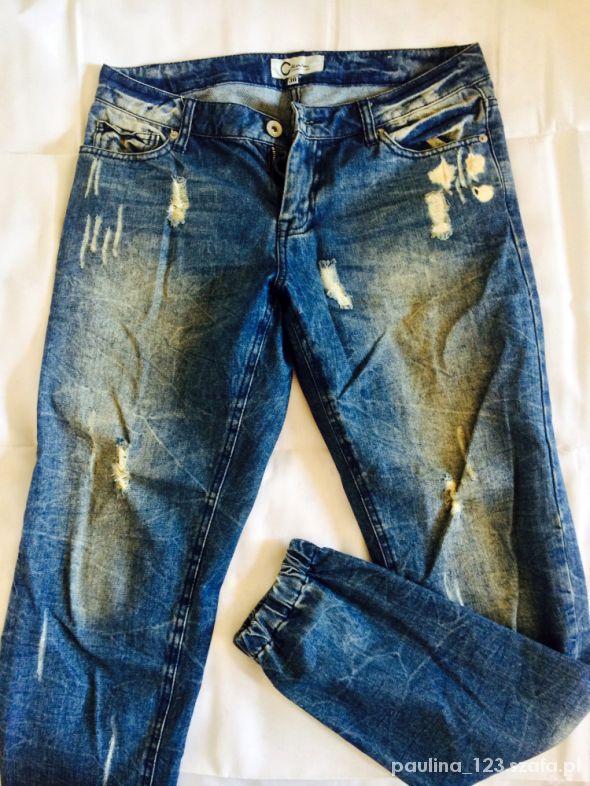 Boyfriend Jeans spodnie z przetarciami 36