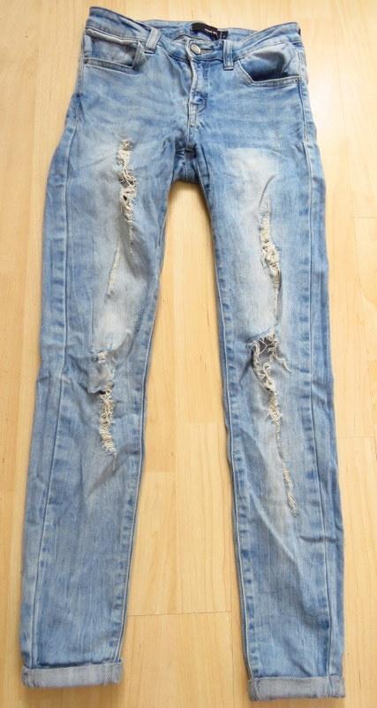 spodnie jeansy przetarcia dziury