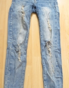 spodnie jeansy przetarcia dziury...