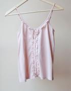 Różowa pudrowa bluzka na ramiączkach z guziczkami...