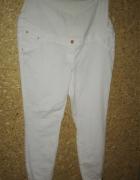 Białe spodnie ciążowe rurki z panelem 46...