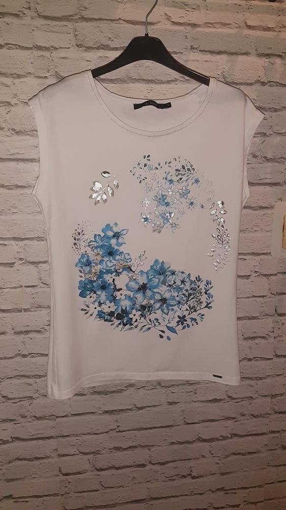 Biała bluzka z ozdobami