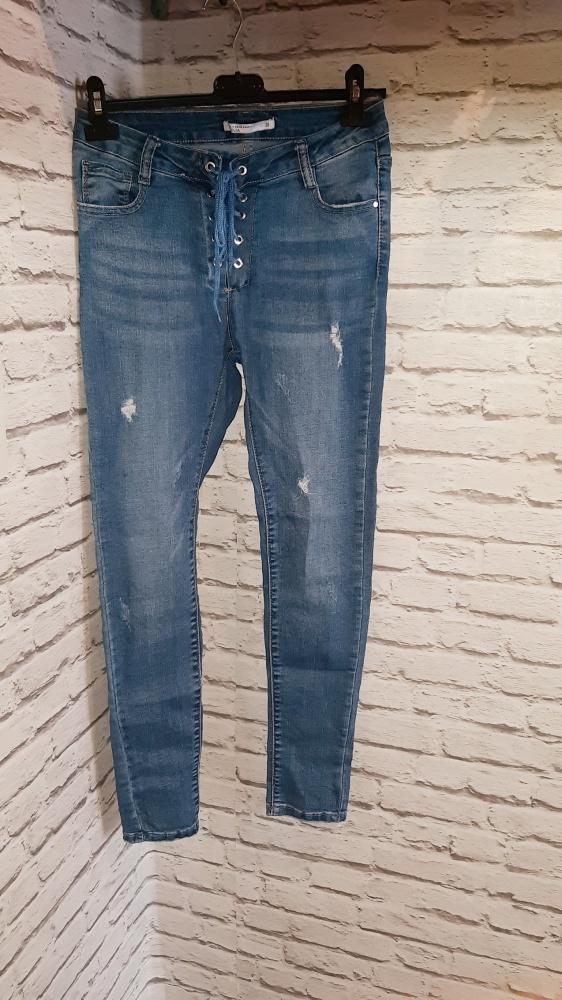 Spodnie jeansy rurki wiązane
