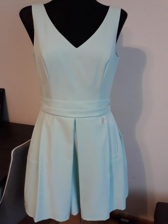 Miętowa sukienka L jak nowa