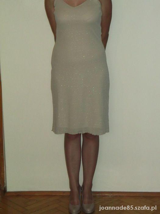 Kremowa sukienka z brokatem...