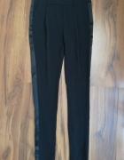 Czarne spodnie z lampasami H&M rozmiar 34...