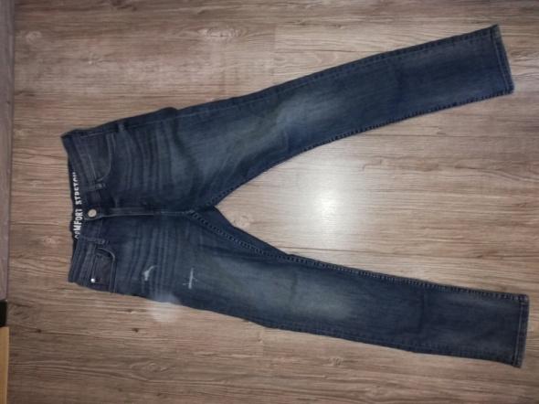 Spodnie i spodenki Niebieskie jeansy H&M