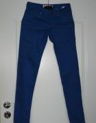 Nowe spodnie Cropp 32...