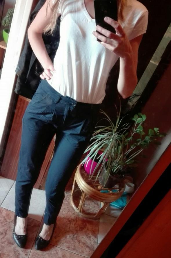 Eleganckie granatowe spodnie Vero Moda...
