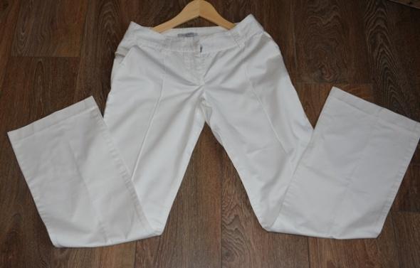 Spodnie Białe spodnie Reserved 36