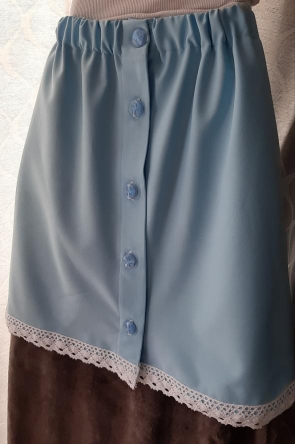Spódnice Spódnica zapinana na guziczki wykonczona koronka baby blue
