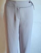 Eleganckie spodnie za kostkę r 42...