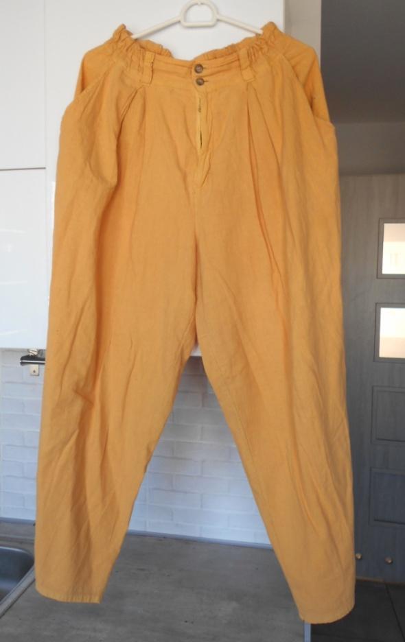 vintage pomarańczowe luźne spodnie baggy...