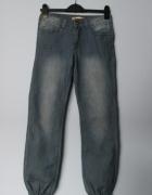 Granatowe jeansy alladynki...