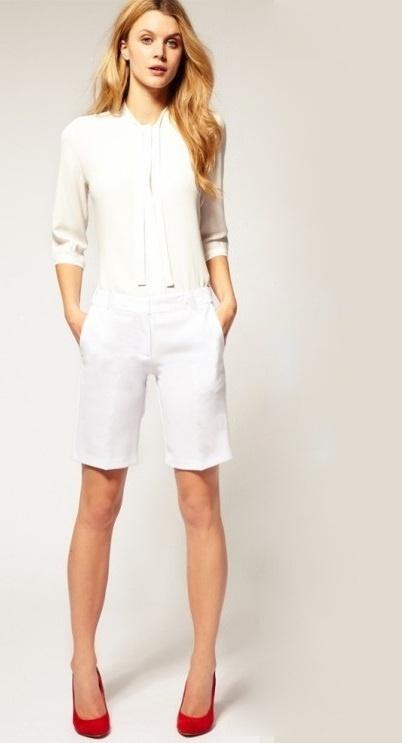 RESERVED białe eleganckie krótsze spodnie r 34