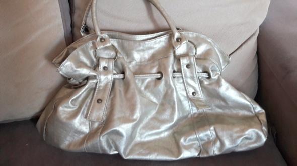 Złota damska torebka do ręki