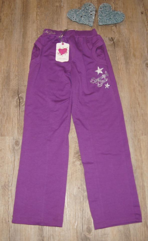 Spodnie dresowe dziewczynka fiolet nowe rozm 146...