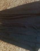 Czarna bluzka rozkloszowana...