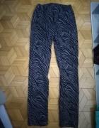 spodnie w zwierzęcy print...