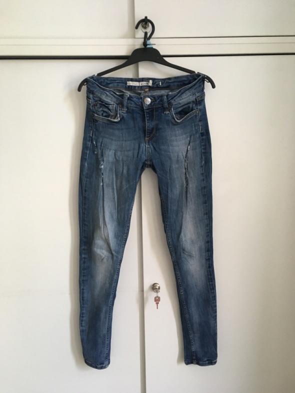 jeansy Topshop rozm 38