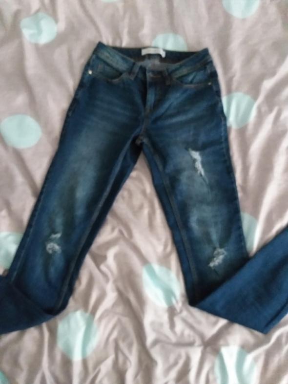 Spodnie Jeansy przetarcia rurki
