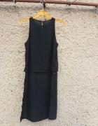 Elegancka czarna bluzka z rozcięciem z boku M...